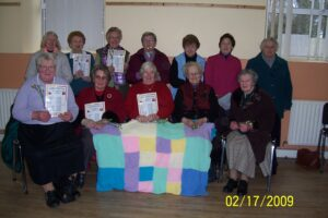 Group from Galbally who hand knitted a throw which was raffled off as part of a fundraising event in 2009